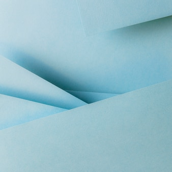 Papiers de couleur bleue fond de bannière composition géométrie