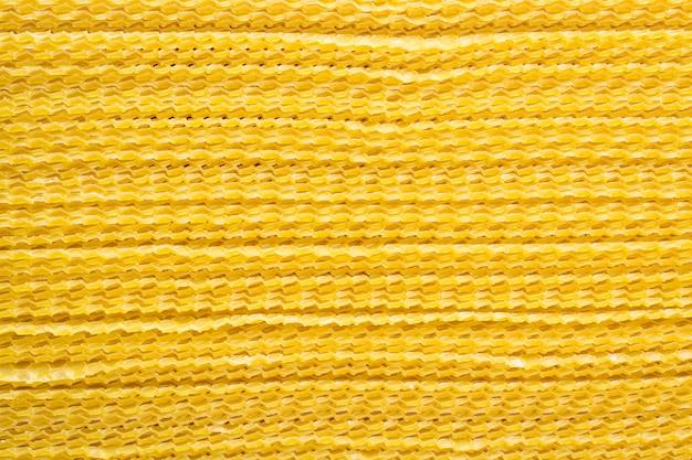 Un paquet de fond de cire jaune en nid d'abeille