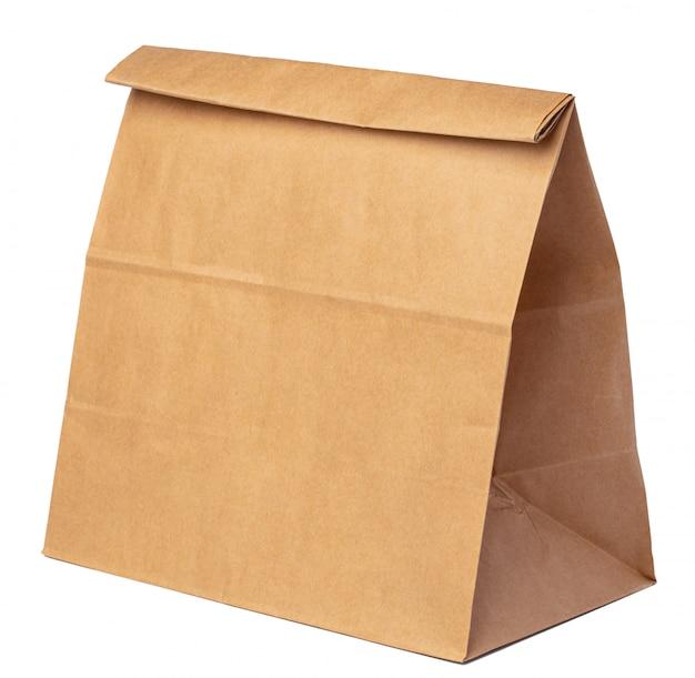 Paquet de papier artisanal pour la nourriture sur fond blanc