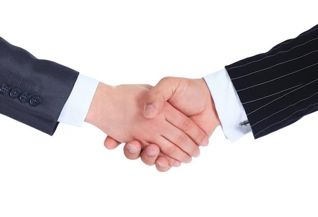Partenaires commerciaux de poignée de main confiants.