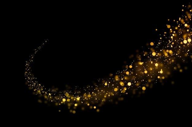 Particules abstraites de bokeh léger scintillant d'or sur fond sombre.