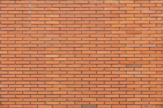 Partie horizontale du mur de maçonnerie en brique orange