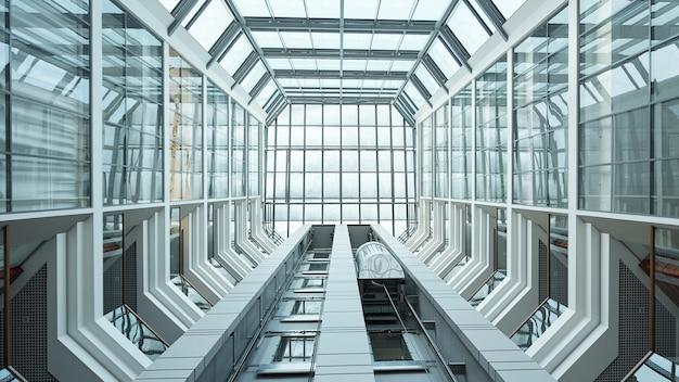 Partie de l'intérieur d'un centre d'affaires contemporain ou d'un immeuble de bureaux avec ascenseur vers le haut et fenêtres