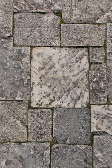 Partie d'un mur de pierre, pour le fond ou la texture, couleur naturelle.