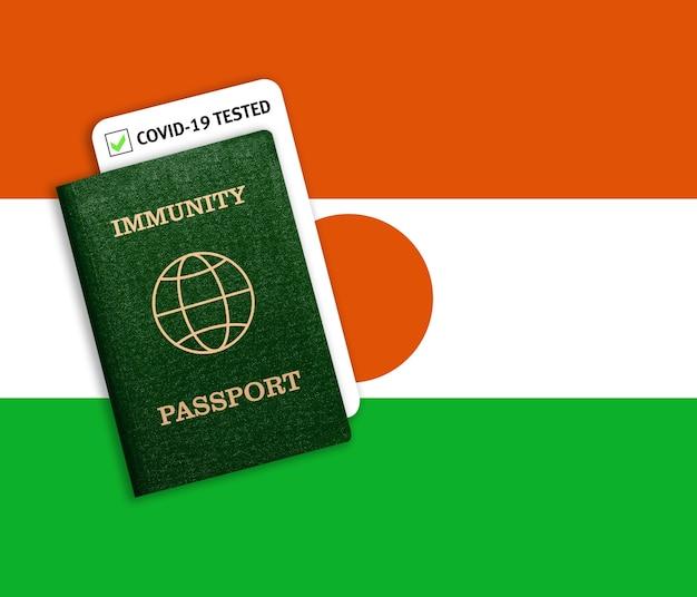 Passeport d'immunité avec test covid sur le drapeau national du nigéria