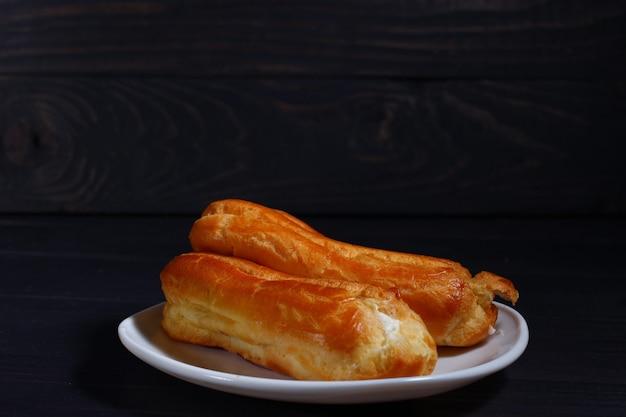 Pâte à choux close up on dark
