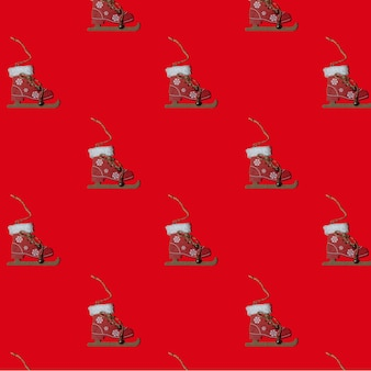 Pattern jouet du nouvel an patins sur un arbre de noël sur un concept de noël de fond carré rouge