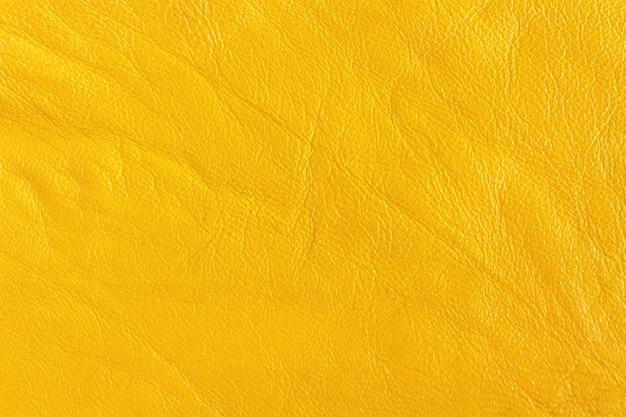 Peau artificielle de couleur jaune. fond, texture
