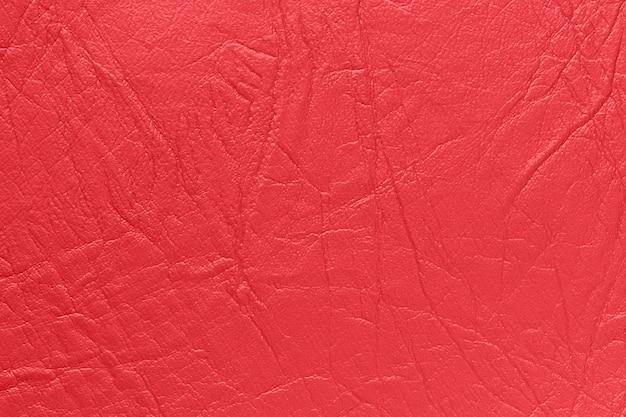 Peau artificielle de couleur rouge. fond, texture