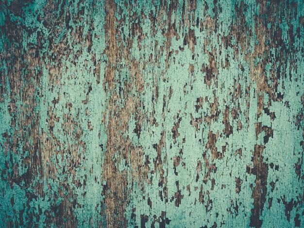 Peint bleu uni vintage sur la texture de la planche de bois