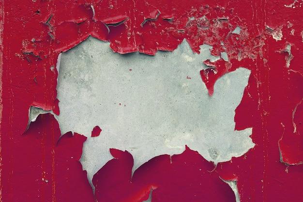 Peint, fané, plâtré, murs peints en rouge. porté vieux closeup détail concret. fond texturé