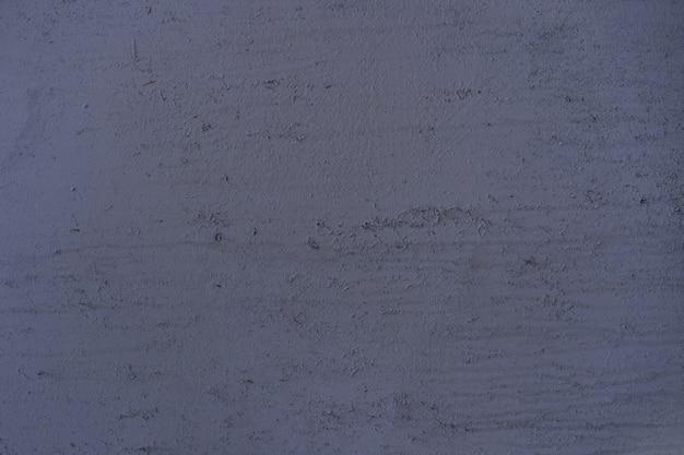 Peint en violet vieux fond de métal fissuré rouillé.