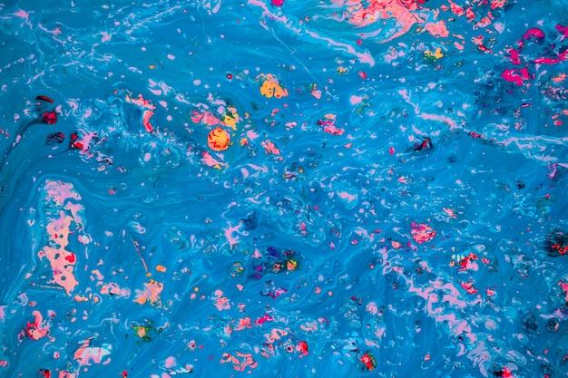 Peinture abstraite rose et bleu sur toile en utilisant la technique acrylique liquide. texture de tranche de marbre