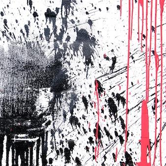 Peinture en aérosol noir et corail pour graffiti sur fond blanc