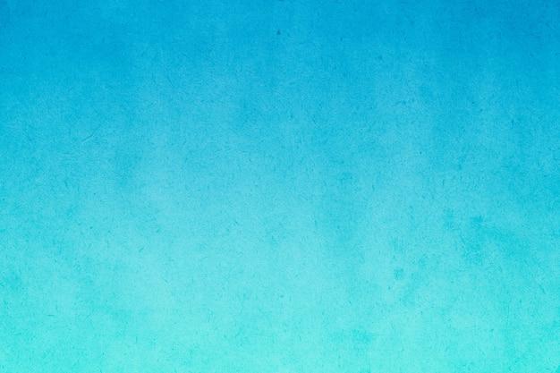 Peinture aquarelle dégradé bleu sur vieux papier avec des taches de grain sale texture abstraite pour le fond