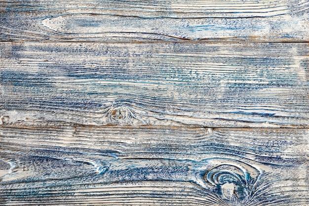 Peinture bleue blanche sur des planches de bois usagées, plusieurs planches