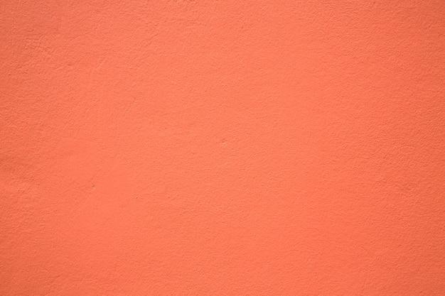 Peinture de couleur orange sur un mur en béton