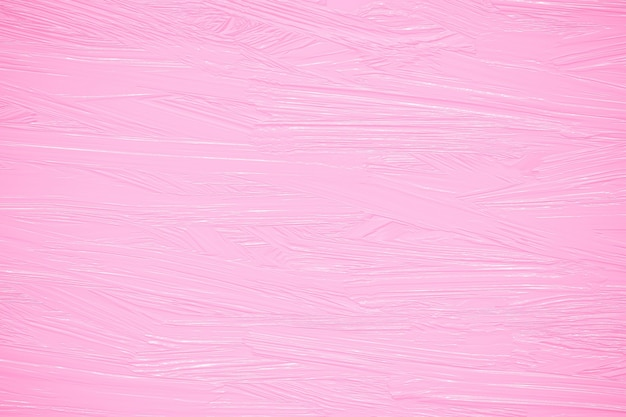 Peinture à l'huile rose sur un mur, coups de pinceau rugueux sur toile