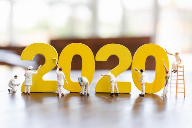 Peinture miniature de l'équipe de travailleurs en 2020