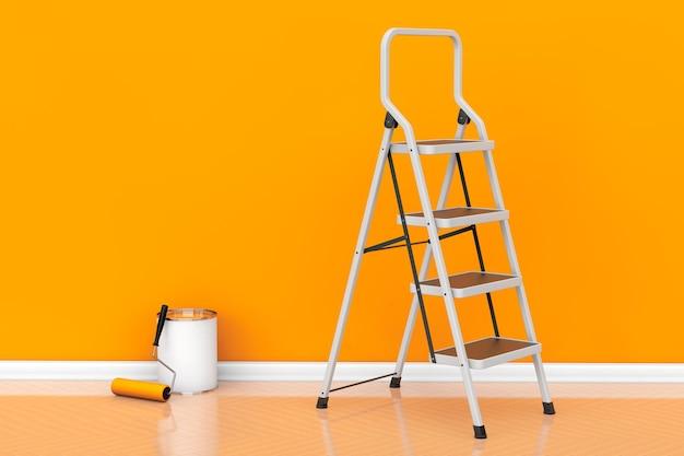 Peinture des murs dans un concept de couleur orange. pot de peinture avec brosse à rouleau et échelle