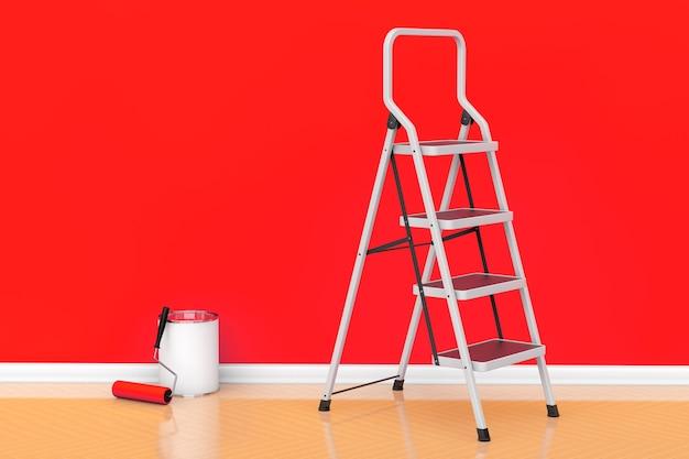 Peinture des murs dans un concept de couleur rouge. pot de peinture avec brosse à rouleau et échelle