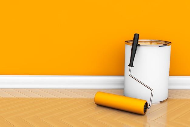 Peinture des murs dans une couleur orange. pot de peinture avec brosse à rouleau