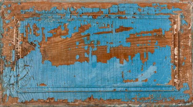 Peinture de planche de bois de style vintage ou minable bleu décollant une planche de bois