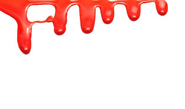 Peinture rouge dégoulinant isolé sur papier blanc