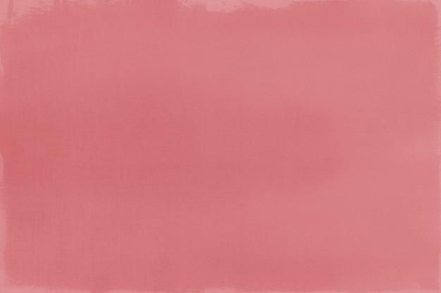 Peinture rouge sur un fond texturé de toile