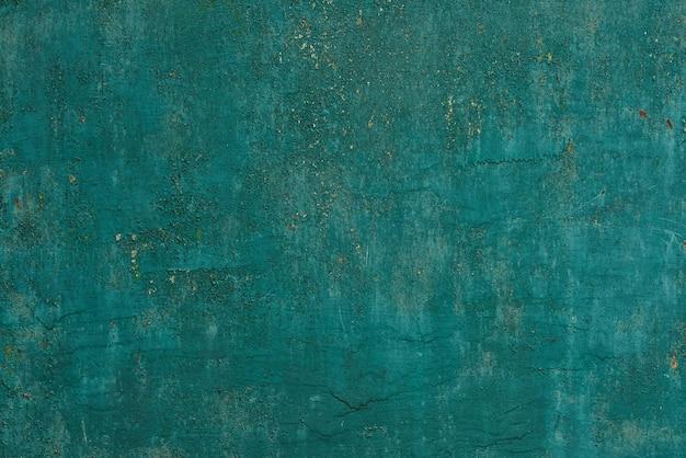 Peinture turquoise écaillée sur la texture transparente du mur. modèle de matériel grunge turquoise rustique.