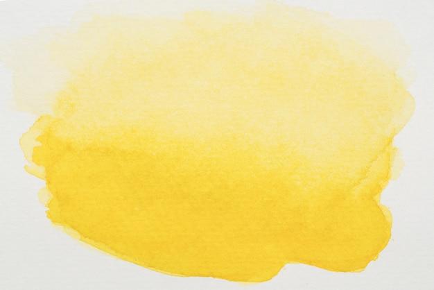 Peintures jaunes sur feuille blanche