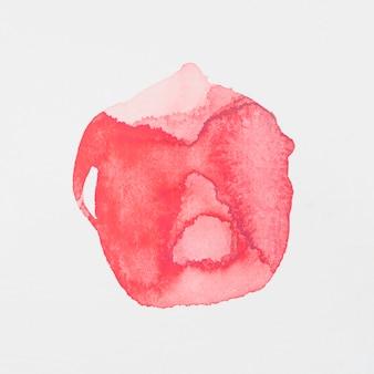 Peintures rouges en forme de cercle sur papier blanc