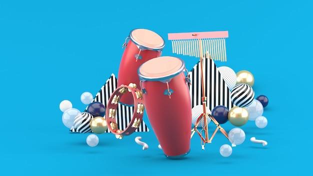 Percussion sur boules colorées sur bleu. rendu 3d.
