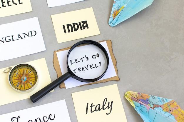 Permet de voyager mots de texte, sélection du pays, carte loupe boussole, fond gris