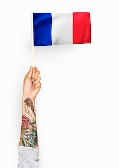 Personne agitant le drapeau de la république française