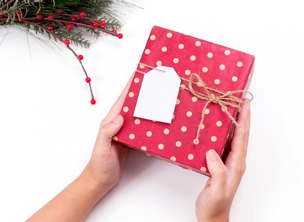Personne, tenue, boîte cadeau noël