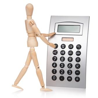 Petit mannequin en bois et calculatrice