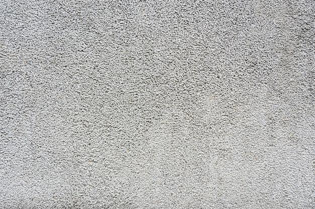 Petit mur de gravier mélanger avec de la pierre grise blanche et noire pour former un mur ou un sol dans le bâtiment.