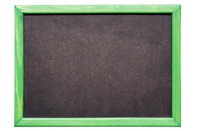 Petit tableau noir propre disposé dans un cadre en bois vert