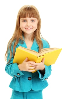 Petite Fille Mignonne Lisant Un Livre D'isolement Sur Le Blanc Photo Premium