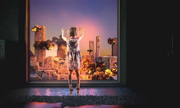 Une petite fille regarde par la fenêtre une ville en feu. bâtiments détruits, explosions. notion d'apocalypse.