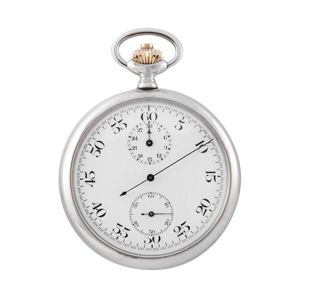 Petite horloge en argent sur une surface blanche