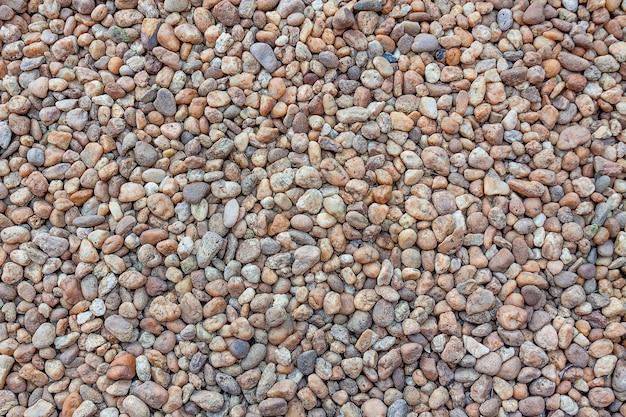 Petits cailloux colorés ou fond de pierres et texture extrême gros plan.