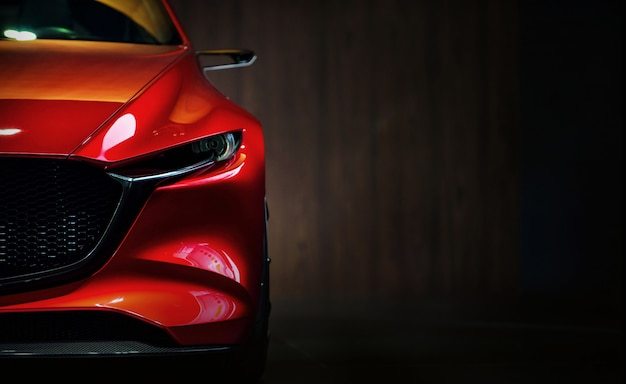 Phares de voiture moderne rouge sur fond noir