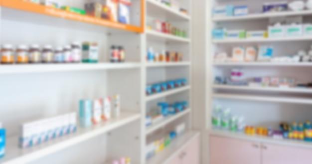 Pharmacie pharmacie flou fond abstrait avec des médicaments et des produits de santé sur des étagères