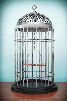 Photo à l'ancienne. cage à oiseaux en métal sur la table
