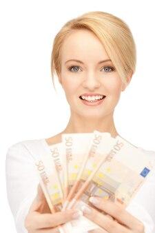 Photo de belle femme avec de l'argent en euros