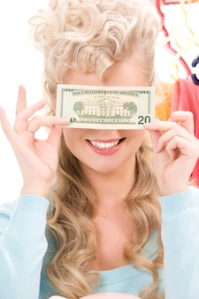 Photo de belle femme avec un billet d'un dollar
