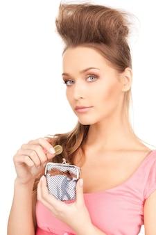 Photo de belle femme avec sac à main et argent