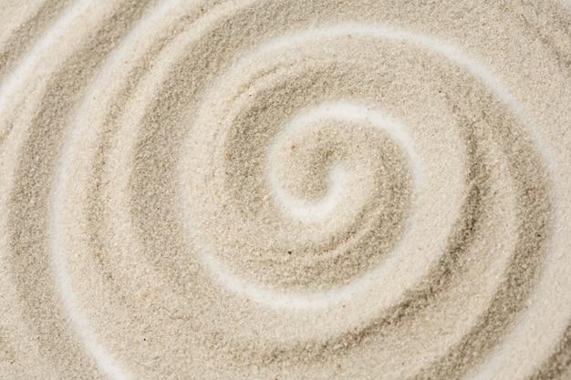 Photo du motif en spirale dans le sable